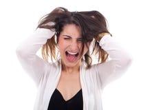 Mujer joven con la expresión del pánico Foto de archivo libre de regalías