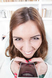 Mujer joven con la expresión loca de la cara Fotografía de archivo libre de regalías