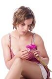 Mujer joven con la flor Fotos de archivo libres de regalías