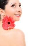 Mujer joven con la flor Foto de archivo libre de regalías