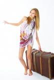 Mujer joven con la maleta Foto de archivo