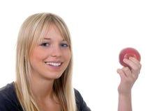 Mujer joven con la manzana Imagen de archivo libre de regalías