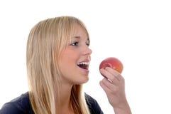 Mujer joven con la manzana Imagenes de archivo