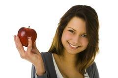 Mujer joven con la manzana roja Fotos de archivo