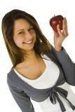 Mujer joven con la manzana roja Imagenes de archivo