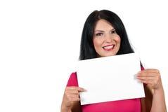 Mujer joven con la muestra en blanco Imagen de archivo