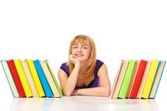 Mujer joven con la pila de libros Imagenes de archivo