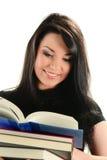 Mujer joven con la pila de libros aislados en blanco Imagen de archivo libre de regalías