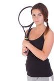 Mujer joven con la raqueta de tenis imagen de archivo