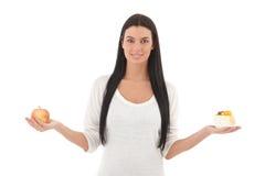 Mujer joven con la sonrisa de la manzana y de la torta Foto de archivo libre de regalías