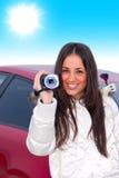 Mujer joven con la videocámara Imagen de archivo