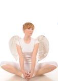 Mujer joven con las alas del ángel foto de archivo