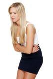 Mujer joven con las ediciones del estómago Imagen de archivo libre de regalías