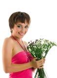 Mujer joven con las flores salvajes Fotos de archivo libres de regalías