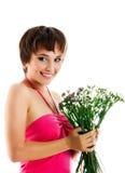 Mujer joven con las flores salvajes Foto de archivo