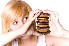 Mujer joven con las galletas Imagenes de archivo