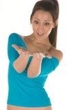 Mujer joven con las palmas para arriba Imagen de archivo