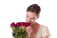Mujer joven con las rosas rojas Fotografía de archivo libre de regalías