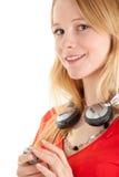Mujer joven con los auriculares Imágenes de archivo libres de regalías