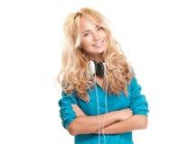 Mujer joven con los auriculares. Fotos de archivo libres de regalías