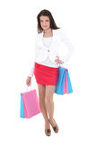 Mujer joven con los bolsos de compras Foto de archivo