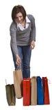 Mujer joven con los bolsos de compras Imágenes de archivo libres de regalías