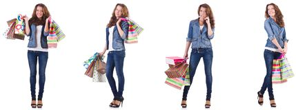 Mujer joven con los bolsos de compras aislados en blanco fotos de archivo libres de regalías