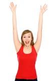 Mujer joven con los brazos levantados Imagen de archivo