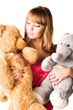 Mujer joven con los juguetes Fotografía de archivo