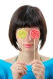 Mujer joven con los lollipops Fotos de archivo libres de regalías