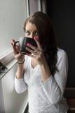 Mujer joven con los ojos azules hermosos Imagenes de archivo