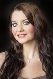 Mujer joven con los ojos azules hermosos Fotos de archivo