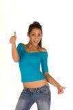 Mujer joven con los pulgares para arriba Imagen de archivo libre de regalías