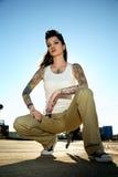 Mujer joven con los tatuajes Foto de archivo libre de regalías