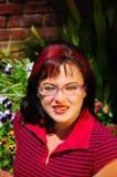 Mujer joven con los vidrios foto de archivo libre de regalías