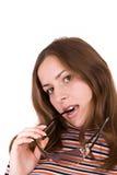 Mujer joven con los vidrios de sol foto de archivo libre de regalías