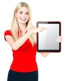 Mujer joven con PC de la tablilla Imagen de archivo libre de regalías