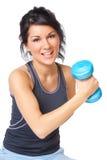 Mujer joven con pesa de gimnasia imagen de archivo