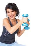 Mujer joven con pesa de gimnasia Imágenes de archivo libres de regalías