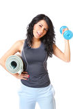 Mujer joven con pesa de gimnasia fotografía de archivo libre de regalías