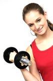 Mujer joven con pesa de gimnasia fotos de archivo libres de regalías
