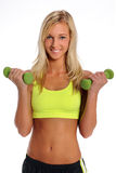 Mujer joven con pesas de gimnasia Foto de archivo