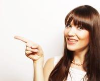mujer joven con su dedo para arriba Foto de archivo libre de regalías