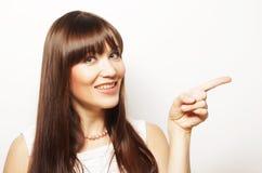 mujer joven con su dedo para arriba Imagenes de archivo