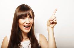 mujer joven con su dedo para arriba Fotografía de archivo