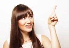 mujer joven con su dedo para arriba Imagen de archivo