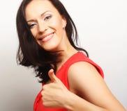mujer joven con su dedo para arriba Fotografía de archivo libre de regalías