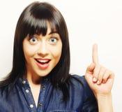 mujer joven con su dedo para arriba ¡Buena idea! Fotografía de archivo