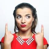 mujer joven con su dedo para arriba ¡Buena idea! Foto de archivo libre de regalías