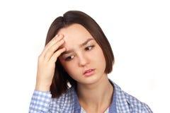 Mujer joven con un dolor de cabeza Imagenes de archivo